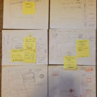 Several sheets of paper showing rough interface sketches