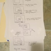 Stack of papers show hand-drawn wireframe interfaces